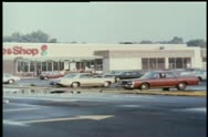Wide shot of store parking lot Stock Footage