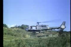 Military helicopter taking off in field Stock Footage