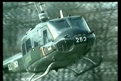 Military helicopter landing in field Stock Footage