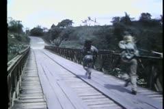 Rear view soldiers running across bridge Stock Footage