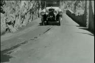 Stock Video Footage of Vintage car driving off mountain and crashing into ocean