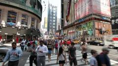 Times Square intersection people walking time lapse fast 30p - stock footage