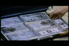 People removing money printing plates from a suitcase Stock Footage