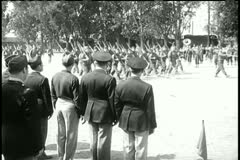 Parade of American soldiers marching as crowd watches - stock footage