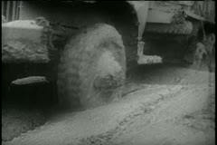 Low-angle view trucks driving through muddy road Stock Footage