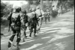 Rear view soldiers scattering  from road - stock footage
