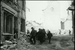 Soldiers walking through bombed out building Stock Footage
