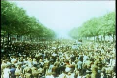 Crowd celebrating liberation on the Champs Elysees at the end of World War II Stock Footage