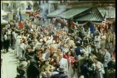 Crowd celebrating liberation in the streets at the end of World War II - stock footage