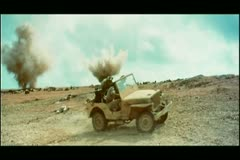 Military jeep driving away from explosions Stock Footage