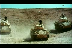 Wide shot military tanks in desert Stock Footage