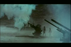 Wide shot soldiers firing cannons Stock Footage