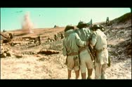 Stock Video Footage of Soldiers helping a wounded comrade