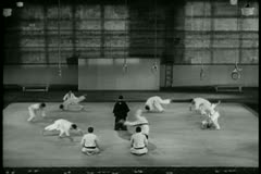 Wide shot martial arts training class - stock footage