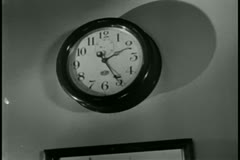Zoom out wall clock to picture frames on wall Stock Footage