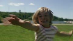 CU Boy running in park - stock footage