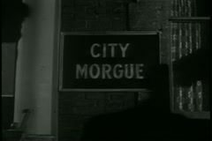 Shadow cast on City Morgue sign Stock Footage