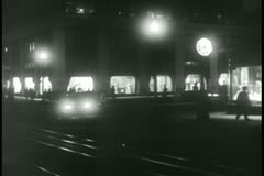 Cars speeding through street at night - stock footage