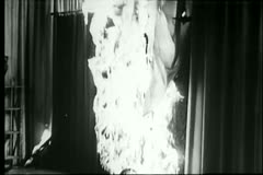 Curtains on fire in theater Stock Footage