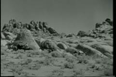 Men on horseback riding through mountain range Stock Footage