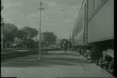 Pullman porter putting down foot stool as train pulls into station Stock Footage