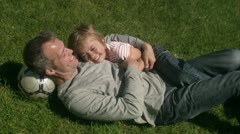 MS Father and son relaxing on grass Stock Footage