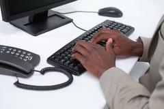 Stock Photo of Close up of masculine hands typing