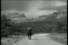 Cowboy riding horse in Sedona, Arizona - stock footage