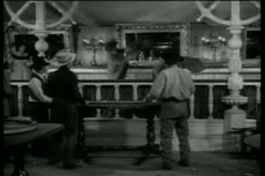 Wide shot of western bar room brawl Stock Footage
