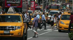 People crossing street Times Square New York City yellow cabs 30p Stock Footage