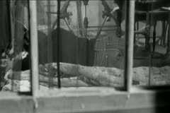 View through window of person sleeping on floor Stock Footage