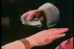 Close-up hands exchanging money Stock Footage