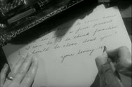 Close-up hands of woman writing letter Stock Footage