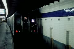 Train pulling out of subway station Stock Footage