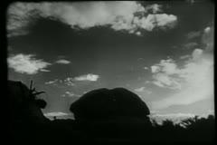 Silhouette of man on horse at sundown Stock Footage