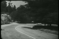 Sports car racing down country road - stock footage