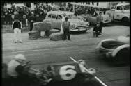 Spectators watching car race Stock Footage