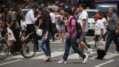 People crossing street Times Square New York City yellow cabs 25p Stock Footage