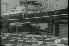 Men unloading cargo from ship Stock Footage