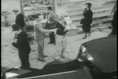 High angle view of man selling newspapers on street Stock Footage