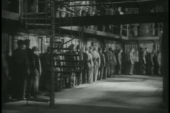Prisoners waiting to get into their cells - stock footage