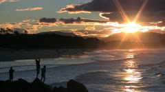 Children fishing at sunset Byron Bay, Australia Stock Footage