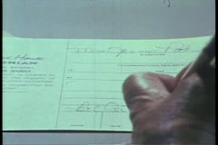Close-up of hand signing name Stock Footage