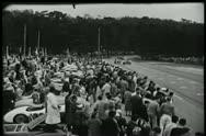 Spectators watching sports car race Stock Footage