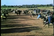 Stock Video Footage of Wide shot medieval soldiers on horseback going into battle