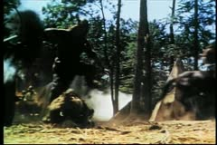 Viking falling to ground with arrow in his chest during battle Stock Footage
