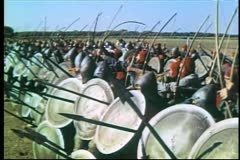 Medieval soldiers shooting arrows at opposition on battlefield - stock footage