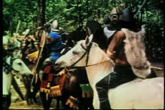 Knights and bandits sword fighting on horseback Stock Footage