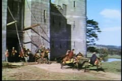 Knights on horseback leaving fortress Stock Footage