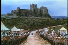 Medieval soldiers lined up on road leading to castle Stock Footage